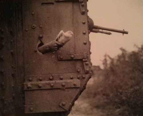 messenger pigeon being released from WWI-era tank portal
